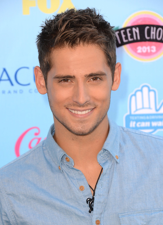 . Jean-Luc Bilodeau arrives at the Teen Choice Awards at the Gibson Amphitheater on Sunday, Aug. 11, 2013, in Los Angeles. (Photo by Jordan Strauss/Invision/AP)