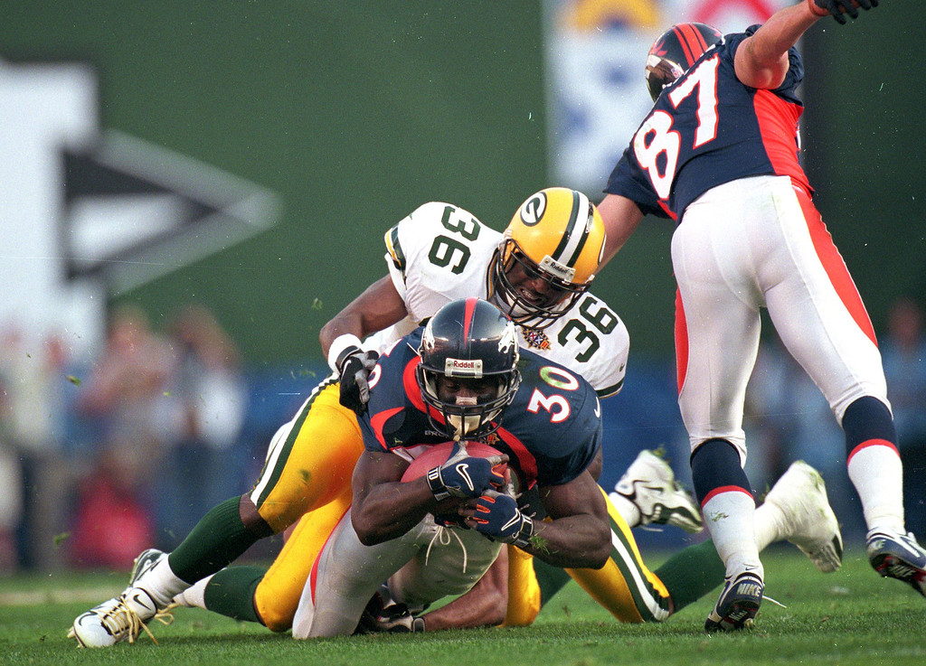 . Terrell Davis #30 of the Denver Broncos in action during the NFL Super Bowl XXXII Game against the Green Bay Packers at the Qualcomm Stadium in San Diego, California. The Broncos defeated the Packers 31-24. (Doug Pensinger/Allsport)