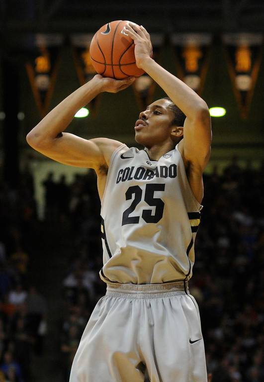 . Buffs point guard Spencer Dinwiddie hit a jump shot from the perimeter in the first half. The University of Colorado men\'s basketball team hosted Colorado State University inside the Coors Events Center Wednesday night, November 5, 2012. Karl Gehring/The Denver Post