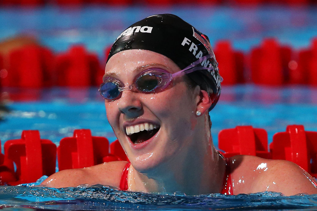. Missy Franklin of the USA celebrates after winning the Swimming Women\'s 100m Backstroke Final on day eleven of the 15th FINA World Championships at Palau Sant Jordi on July 30, 2013 in Barcelona, Spain.  (Photo by Clive Rose/Getty Images)