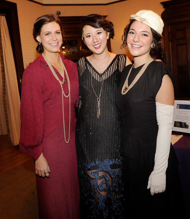 . Friends Cecelia Crossen, left, Connie Jiang, center, and Kalen Acquisto, right, made photogenic trio. The Rocky Mountain PBS Masterpiece Costume Ball attracted more than 200 fans of the Downton Abbey television drama Saturday night, January 4, 2014 at the Grant Humphreys Mansion. The show\'s new season starts Sunday night. The event also included a silent auction, historical displays, and a costume contest. Photo By Karl Gehring/The Denver Post
