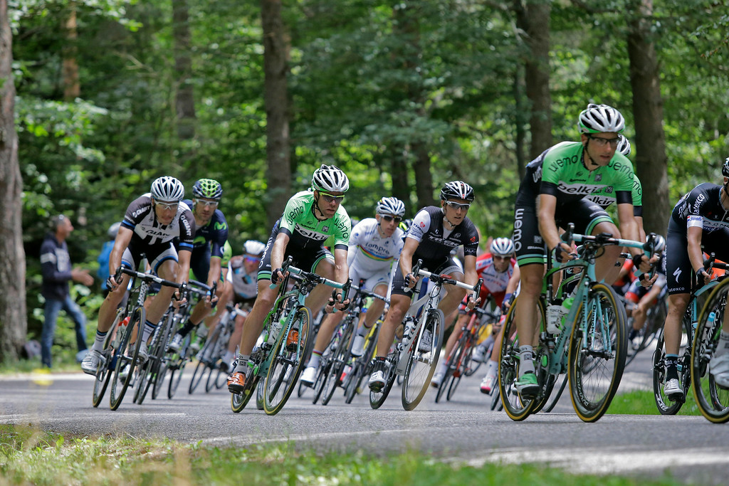 . Netherland\'s Lars Boom, center left in green, and Netherland\'s Bauke Mollema, right in green, ride in the pack during the ninth stage of the Tour de France cycling race over 170 kilometers (105.6 miles) with start in Gerardmer and finish in Mulhouse, France, Sunday, July 13, 2014. (AP Photo/Laurent Cipriani)