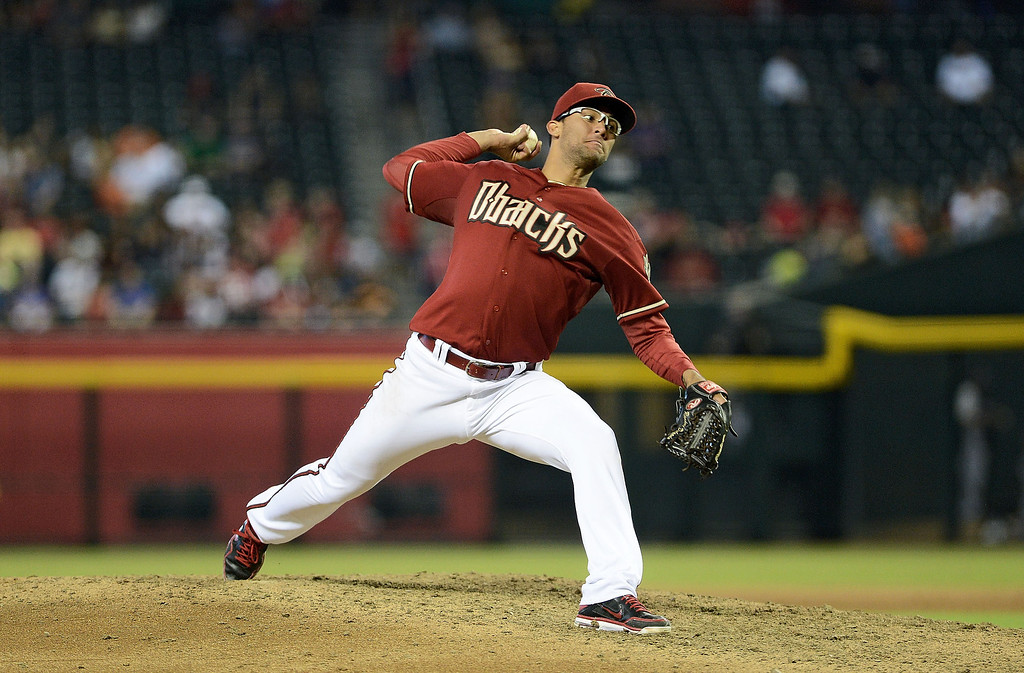 . Pitcher Randall Delgado #48 of the Arizona Diamondbacks pitches against the Colorado Rockies at Chase Field on September 15, 2013 in Phoenix, Arizona.  The Diamondbacks defeated the Rockies 8-2.  (Photo by Jennifer Stewart/Getty Images)