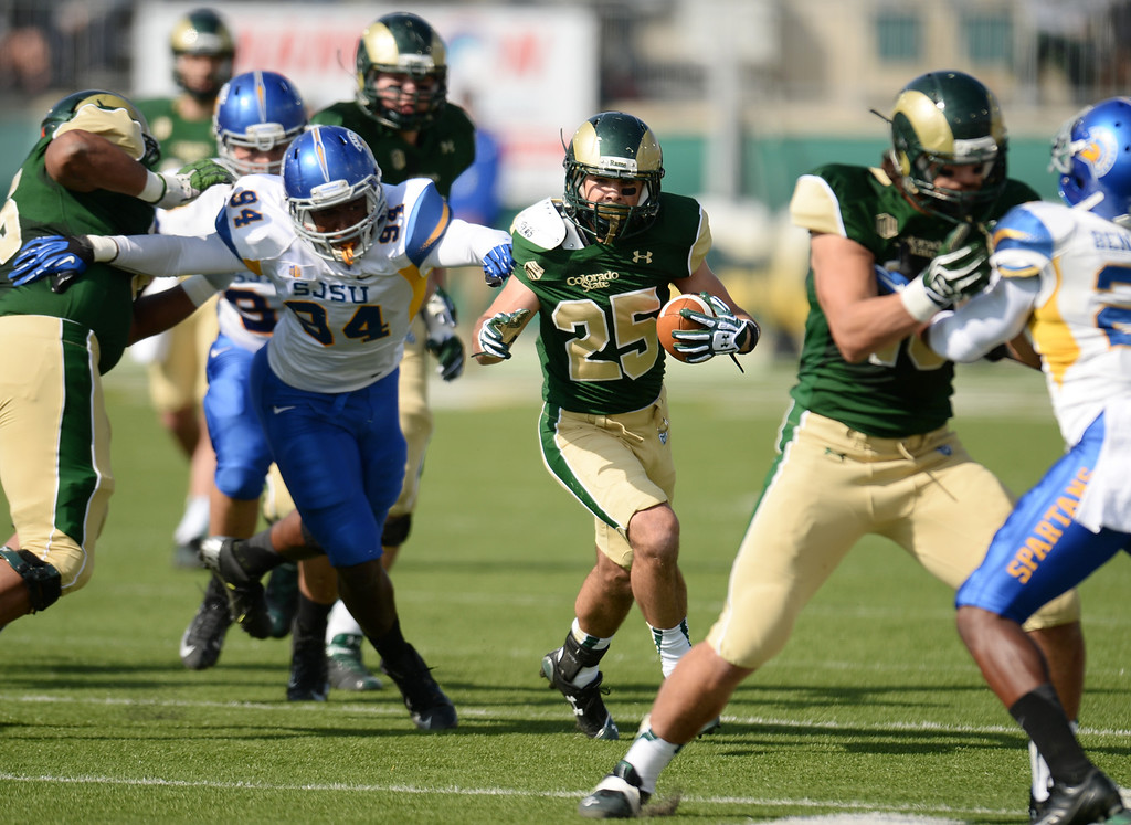 . FORT COLLINS, CO - OCTOBER 12 : Joe Hansley of Colorado State (25) rushes against the San Jose State defense in the 2nd quarter of the game at Hughes Stadium. Fort Collins. Colorado. October 12, 2013. San Jose won 34-27. (Photo by Hyoung Chang/The Denver Post)