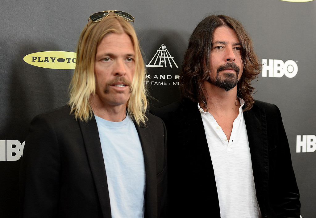 . Musicians Taylor Hawkins, left,  and Dave Grohl of Foo Fighters arrive at the 28th Annual Rock and Roll Hall of Fame Induction Ceremony at Nokia Theatre L.A. Live on April 18, 2013 in Los Angeles, California.  (Photo by Jason Merritt/Getty Images)