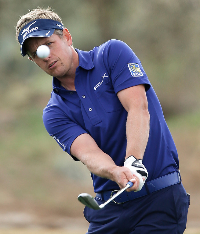 . Luke Donald, of England, hits out of the rough during the first round against Marcel Siem, of Germany, during the Match Play Championship golf tournament, Thursday, Feb. 21, 2013, in Marana, Ariz. Donald won 1 up. (AP Photo/Ted S. Warren)