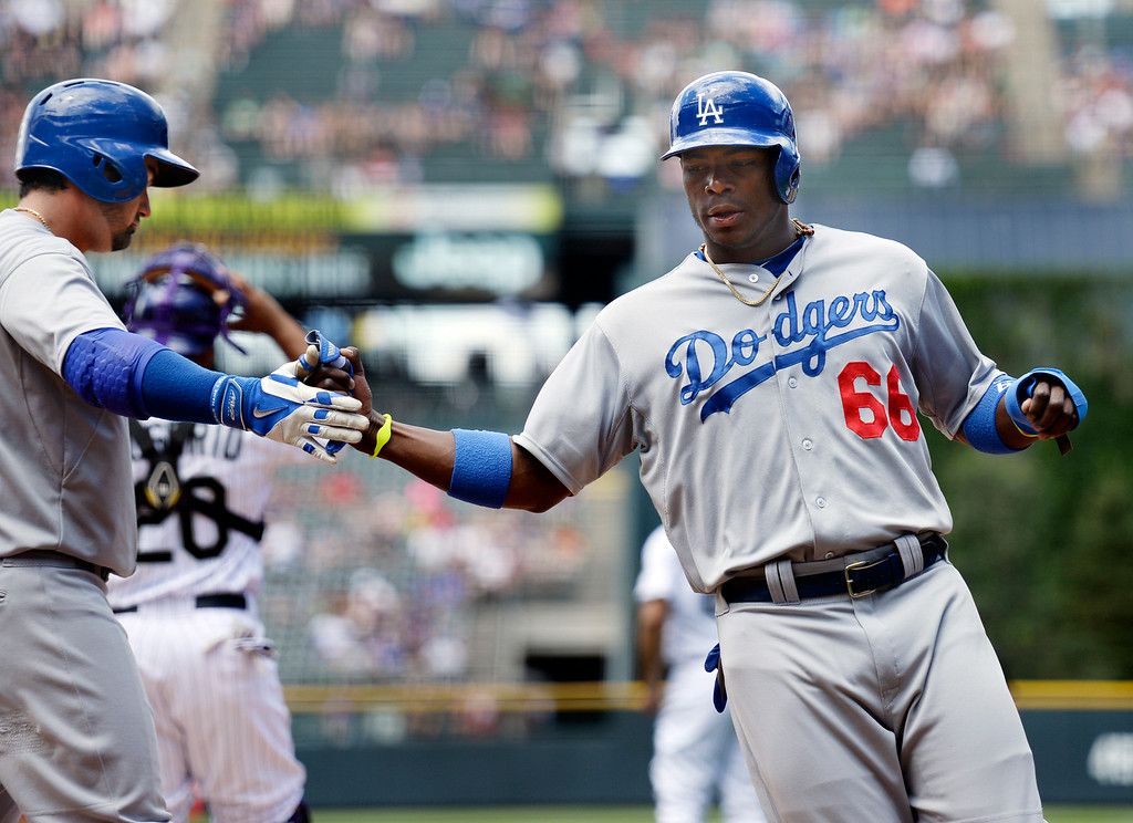. DENVER, CO - JULY 5: Dodgers baserunner crossed the plate in the first inning and was congratulated by teammate Adrian Gonalez, left. The Colorado Rockies hosted the Los Angeles Dodgers at Coors Field Saturday afternoon, July 5, 2014.  Photo by Karl Gehring/The Denver Post