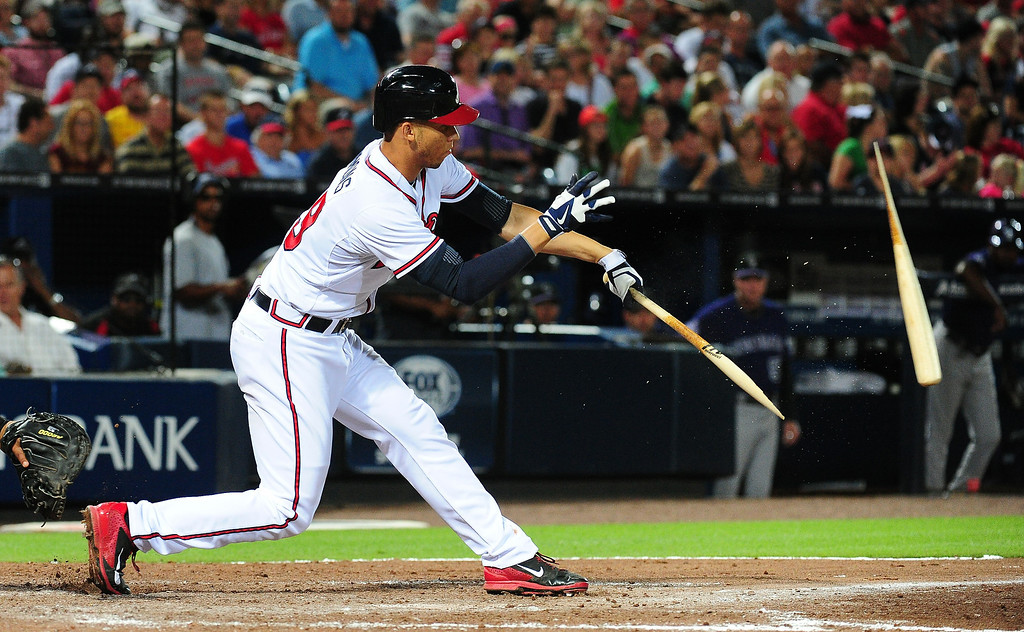 . Andrelton Simmons #19 of the Atlanta Braves breaks his bat while hitting against the Colorado Rockies at Turner Field on July 29, 2013 in Atlanta, Georgia. (Photo by Scott Cunningham/Getty Images)