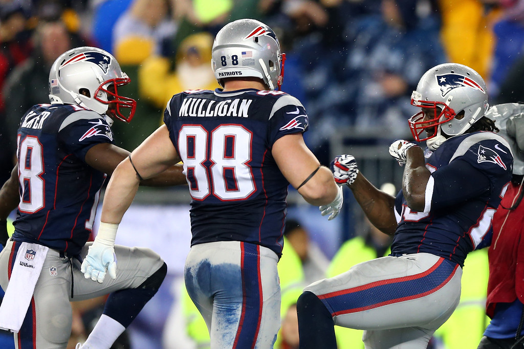 . FOXBORO, MA - JANUARY 11:  LeGarrette Blount #29 of the New England Patriots celebrates with his teammates after scoring a 2 yard touchdown in the second quarter against the Indianapolis Colts during the AFC Divisional Playoff game at Gillette Stadium on January 11, 2014 in Foxboro, Massachusetts.  (Photo by Elsa/Getty Images)