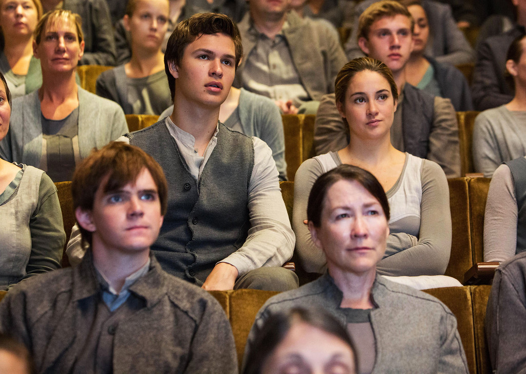 ". This image released by Summit Entertainment shows Ansel Elgort, second row left, and Shailene Woodley, second row right, in a scene from ""Divergent.\"" (AP Photo/Summit Entertainment, Jaap Buitendijk)"
