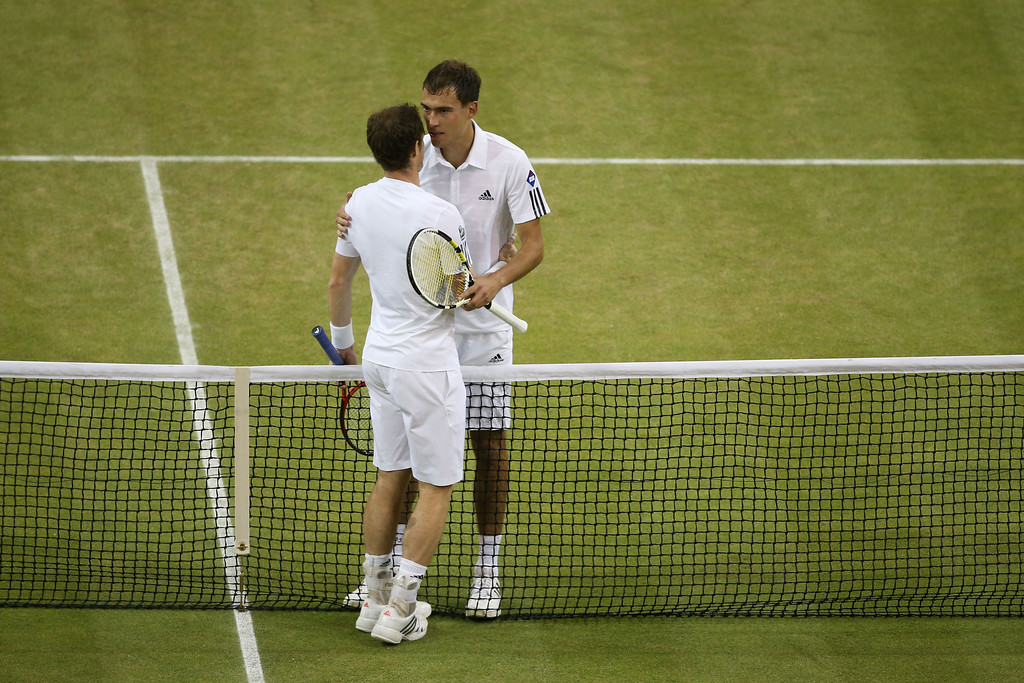 . LONDON, ENGLAND - JULY 05:  Andy Murray of Great Britain speaks with Jerzy Janowicz of Poland at the net after their Gentlemen\'s Singles semi-final match on day eleven of the Wimbledon Lawn Tennis Championships at the All England Lawn Tennis and Croquet Club on July 5, 2013 in London, England.  (Photo by Clive Brunskill/Getty Images)
