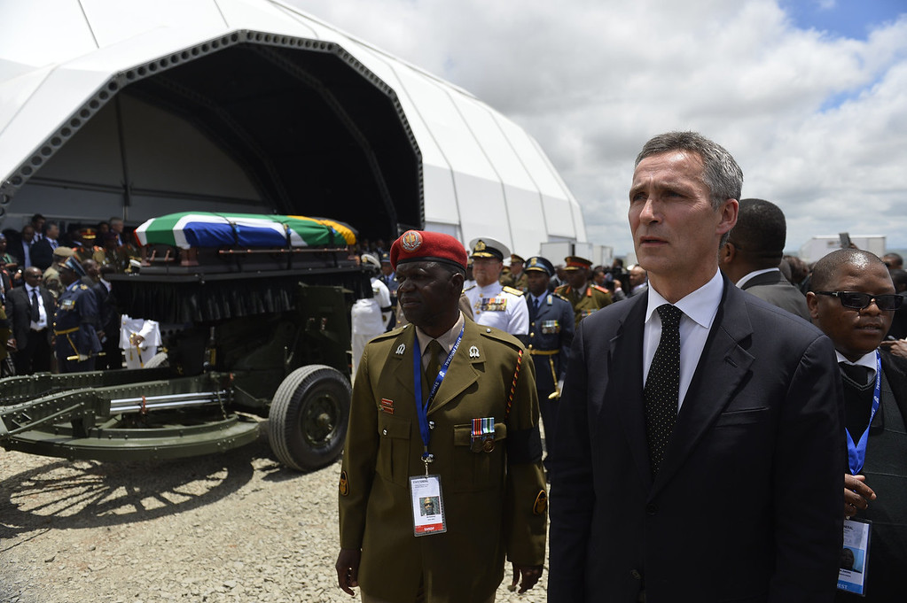. Norway\'s former Prime MinisterJens Stoltenberg (R) stands near the coffin of South African former president Nelson Mandela being taken to the burial site in Qunu on December 15, 2013. South Africa\'s first black president Nelson Mandela received a tearful state funeral at his childhood village of Qunu on Sunday, followed by a traditional burial attended by family and friends Mandela, the revered icon of the anti-apartheid struggle in South Africa and one of the towering political figures of the 20th century, died in Johannesburg on December 5 at age 95.  AFP PHOTO / POOL / ODD ANDERSENODD ANDERSEN/AFP/Getty Images