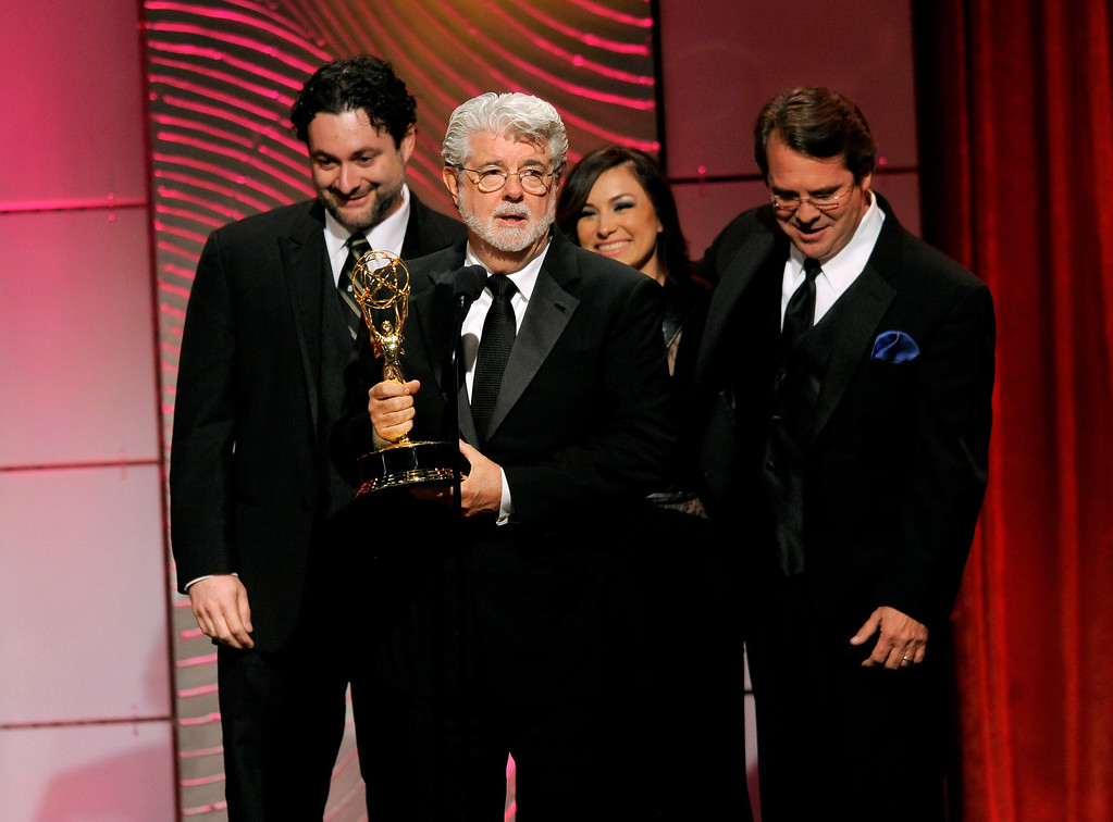 ". George Lucas and the crew of ""Star Wars: The Clone Wars\"" accept the award for outstanding special class animated program at the 40th Annual Daytime Emmy Awards on Sunday, June 16, 2013, in Beverly Hills, Calif. (Photo by Chris Pizzello/Invision/AP)"