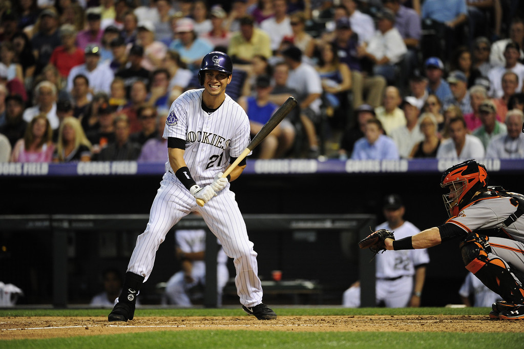 . DENVER - JUNE 28: Tyler Colvin #21, of the Colorado Rockies, grimaces after a strike during the sixth inning of a baseball game against the San Francisco Giants on June 28, 2013 at Coors Field.  (Photo By Grant Hindsley / The Denver Post)