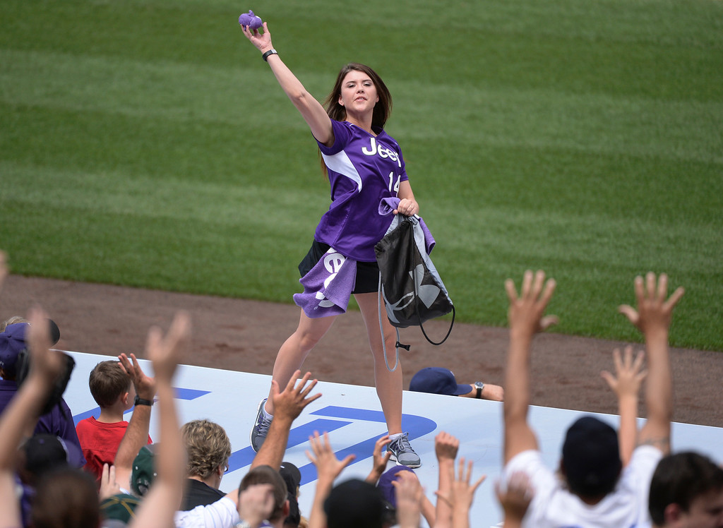 . DENVER, CO - JUNE 21: Fans clamored for free t-shirts being lobbed into the crowd by the team\'s Rally Crew. The Colorado Rockies hosted the Milwaukee Brewers at Coors Field Saturday afternoon, June 21, 2014. Photo by Karl Gehring/The Denver Post