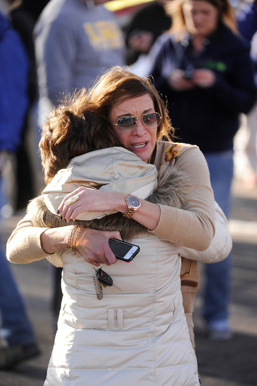 . Parents Cathy Thorson, left, and Heather Moran, facing camera, embraced while they waited for news on their children outside Arapahoe High School Friday afternoon, December 13, 2013. A shooting inside the school sent hundreds of students rushing for safety. Photo By Karl Gehring/The Denver Post