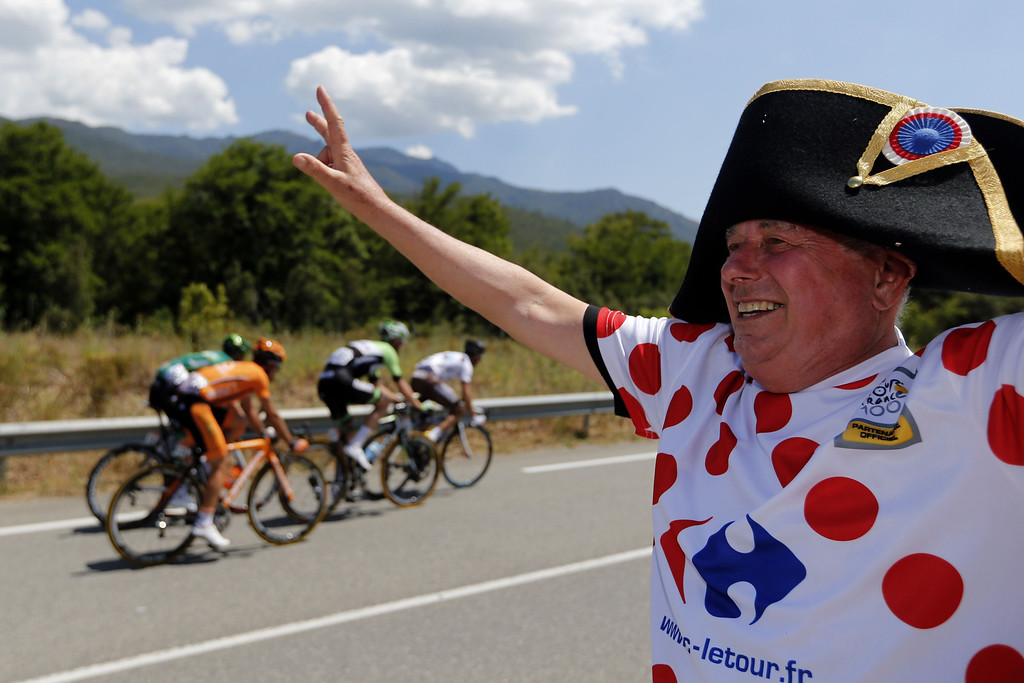 . A disguised fan waves to riders during the 156 km second stage of the 100th edition of the Tour de France cycling race on June 30, 2013 between Bastia and Ajaccio, on the French Mediterranean Island of Corsica.  JOEL SAGET/AFP/Getty Images