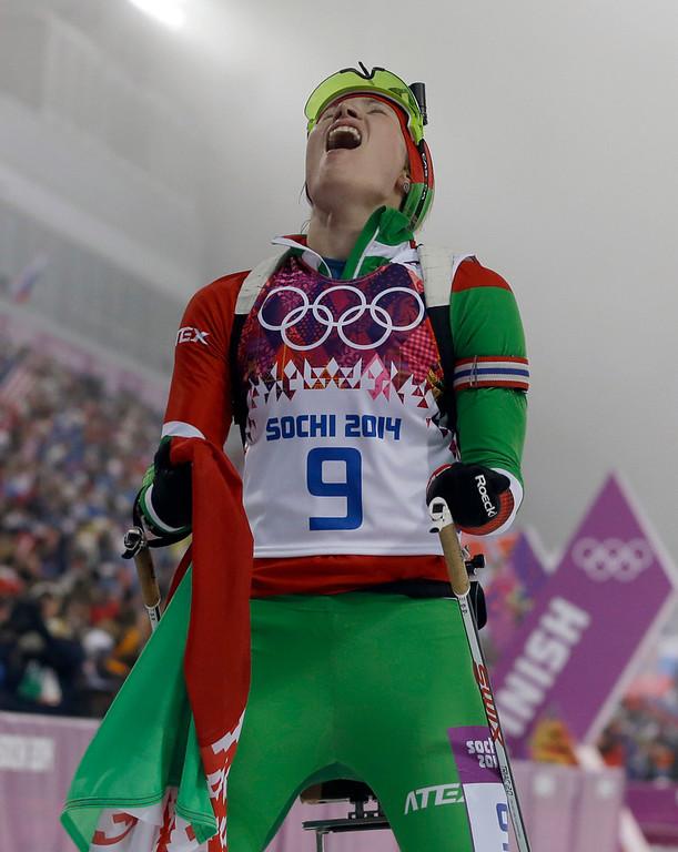 . Belarus\' Darya Domracheva celebrates after winning the gold in the women\'s biathlon 10k pursuit, at the 2014 Winter Olympics, Tuesday, Feb. 11, 2014, in Krasnaya Polyana, Russia. (AP Photo/Kirsty Wigglesworth)