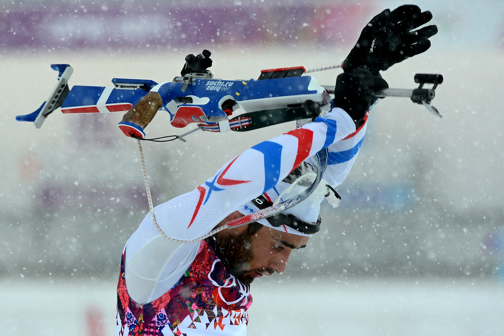 . France\'s Martin Fourcade competes in the Men\'s Biathlon 15 km Mass Start at the Laura Cross-Country Ski and Biathlon Center during the Sochi Winter Olympics on February 18, 2014, in Rosa Khutor, near Sochi. KIRILL KUDRYAVTSEV/AFP/Getty Images
