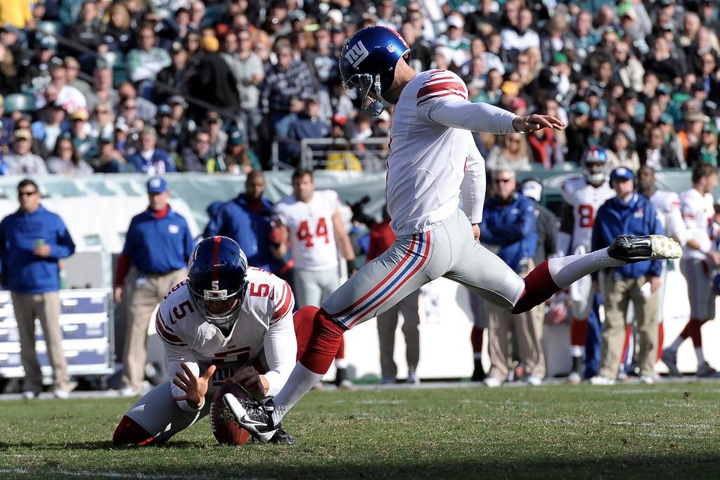 . New York Giants kicker Josh Brown (3) kicks a field goal during the second half of an NFL football game against the Philadelphia Eagles on Sunday, Oct. 27, 2013, in Philadelphia. (AP Photo/Michael Perez)