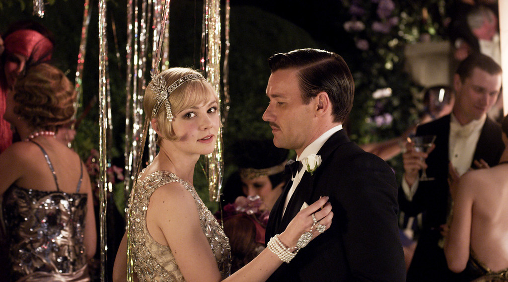 ". (L-r) CAREY MULLIGAN as Daisy Buchanan and JOEL EDGERTON as Tom Buchanan in Warner Bros. Pictures and Village Roadshow Pictures� drama � ""THE GREAT GATSBY,\"" a Warner Bros. Pictures release."