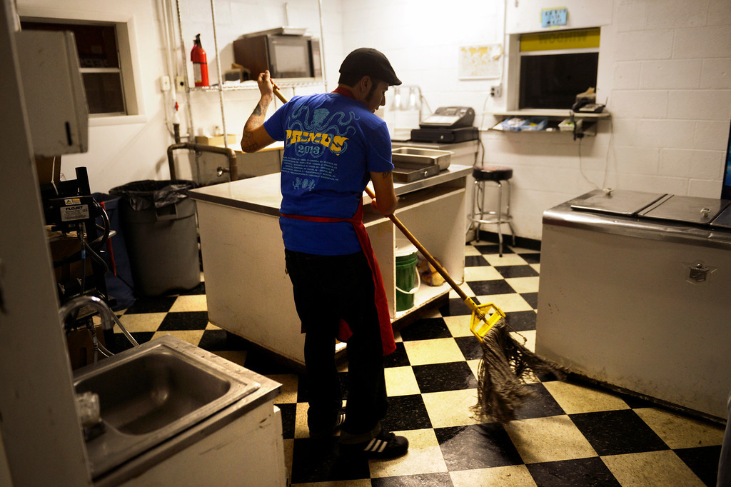 ". PUEBLO, CO. - May 24: Carlos Tomez 25 mopping up after the snack bar closes he is also a ticket taker at the start of the night at the Mesa Drive-in. ""This was my first job,\"" he said. \""I\'m also a musician but this place is my first priority.\"" Tomez has been working here for 8 years. May 24, 2013 Pueblo, Colorado. (Photo By Joe Amon/The Denver Post)"