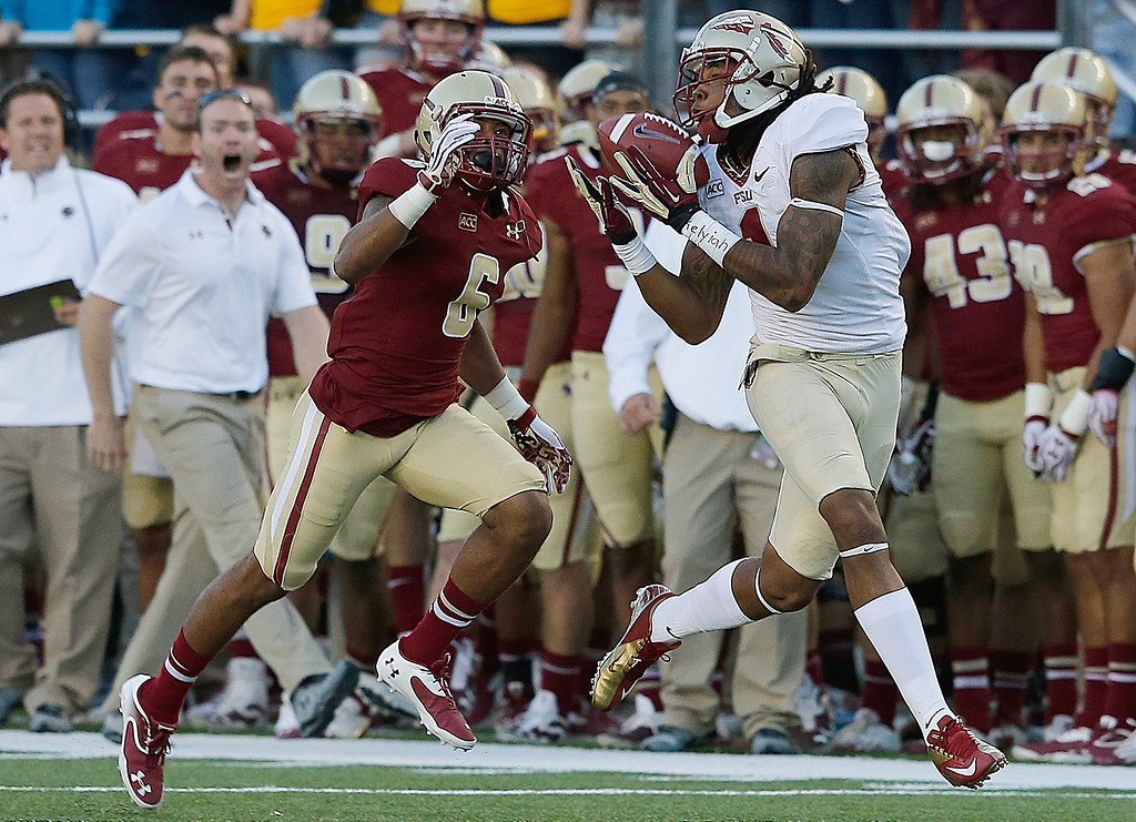 . CHESTNUT HILL, MA - SEPTEMBER 28: Kelvin Benjamin #1 of the Florida State Seminoles makes a catch as C.J. Jones #6 of the Boston College Eagles defends in the second half at Alumni Stadium on September 28, 2013 in Chestnut Hill, Massachusetts. (Photo by Jim Rogash/Getty Images)