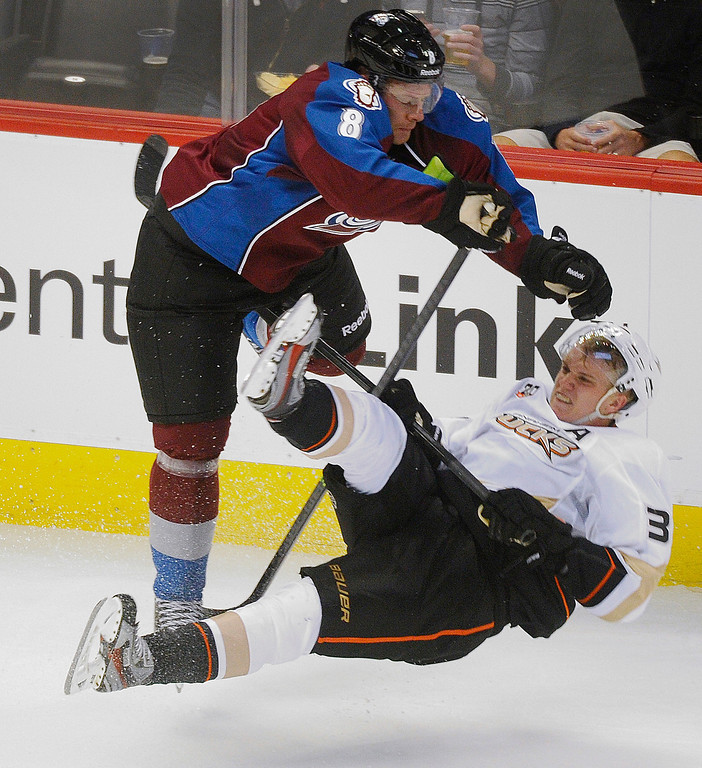 . Colorado defenseman Jan Hejda (8) leveled Anaheim forward Jakob Silfverberg (33) with a check in the second period.  Photo By Karl Gehring/The Denver Post