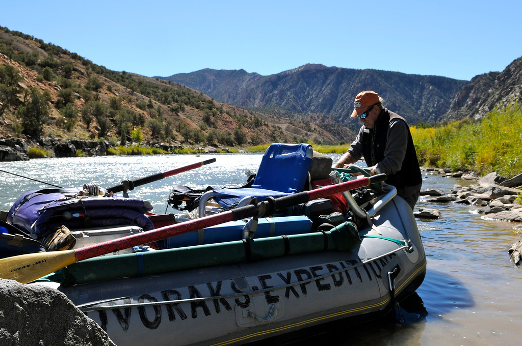 . Bill Dvorak of Dvorak Expeditions readjusts his riging before entering the whitewater downstream of Ute Park. The placid park in the heart of the Gunnison Gorge Wilderness Area offers world-class fishing that is only accessible by boat or a four-mile hike from the rim of the gorge surrounding the Gunnison River\'s gold medal water. Scott Willoughby, The Denver Post