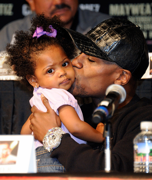 . Boxer Floyd Mayweather Jr. plays with his 19-month-old niece Brielle Smith during the final news conference for his bout against Victor Ortiz at the MGM Grand Hotel/Casino September 14, 2011 in Las Vegas, Nevada. Mayweather will challenge Ortiz for the WBC welterweight title on September 17, 2011 in Las Vegas.  (Photo by Ethan Miller/Getty Images)