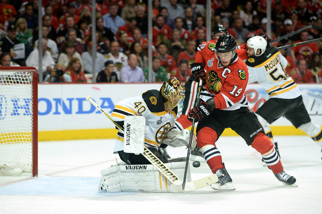 . CHICAGO, IL - JUNE 15:  Jonathan Toews #19 of the Chicago Blackhawks attempts to put the puck on net against goalie Tuukka Rask #40 of the Boston Bruins in Game Two of the NHL 2013 Stanley Cup Final at United Center on June 15, 2013 in Chicago, Illinois.  (Photo by Harry How/Getty Images)