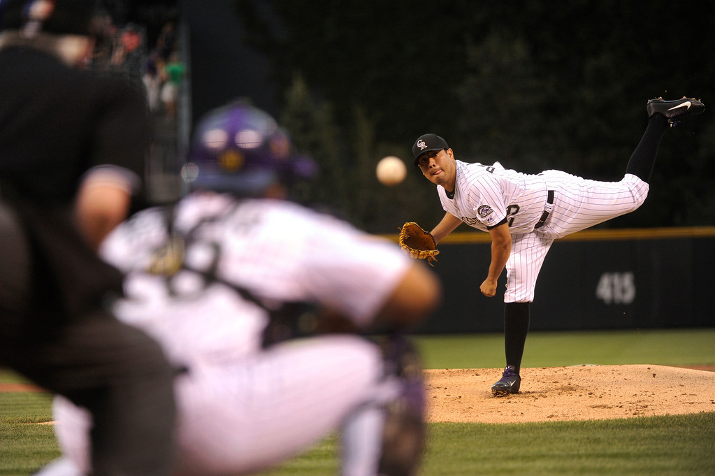 . DENVER, CO. - SEPTEMBER 4: Colorado pitcher Jorge De La Rosa delivered to the plate in the first inning. The Colorado Rockies hosted the Los Angeles Dodgers at Coors Field Wednesday night, September 4, 2013.  Photo By Karl Gehring/The Denver Post
