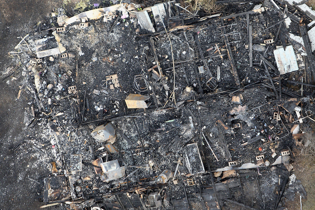. WEST, TX - APRIL 18:  A home burned to the ground by an explosion yesterday at the West Fertilizer Company is seen from the air April 18, 2013 in West, Texas. According to West Mayor Tommy Muska, around 14 people, including 10 first responders, were killed and more than 150 people were injured when the fertilizer company caught fire and exploded, leaving damaged buildings for blocks in every direction.  (Photo by Chip Somodevilla/Getty Images)