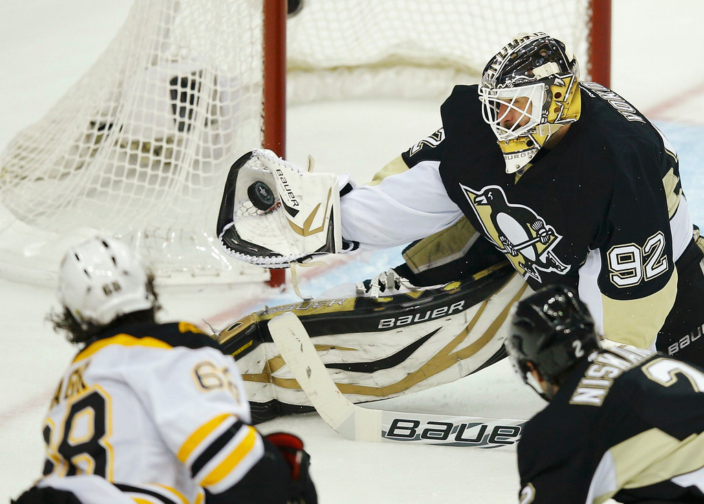 . Pittsburgh Penguins goalie Tomas Vokoun (92) makes a save on Boston Bruins\' Jaromir Jagr (L) during the first period of Game 1 of their NHL Eastern Conference finals hockey playoff series in Pittsburgh, Pennsylvania June 1, 2013.  REUTERS/Brian Snyder