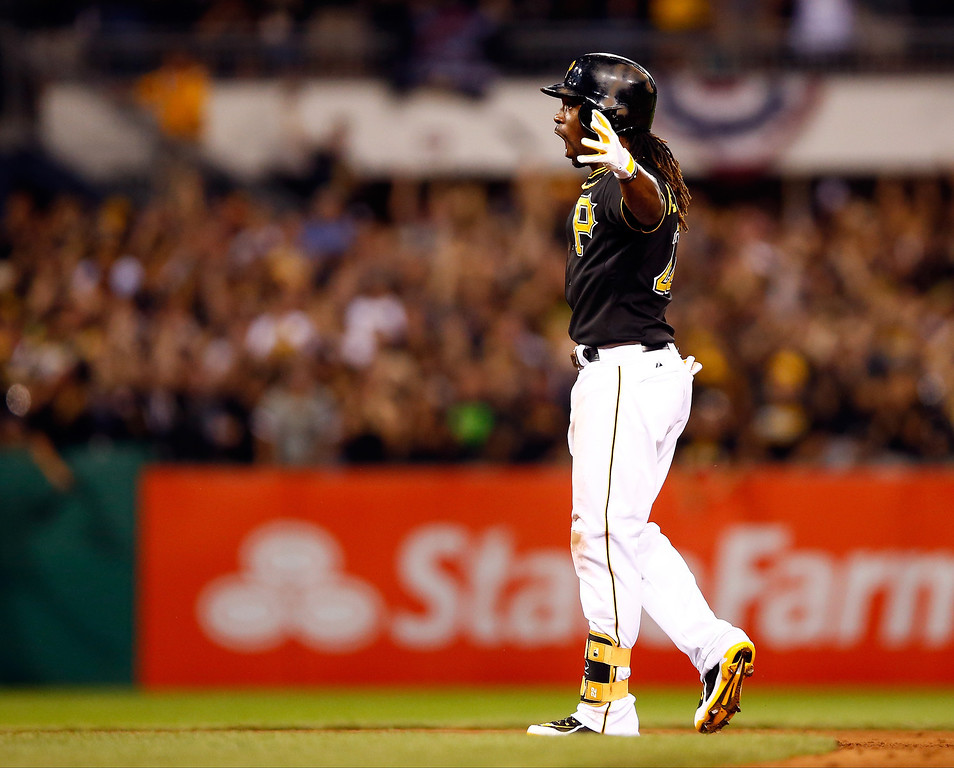 . Andrew McCutchen #22 of the Pittsburgh Pirates celebrates a double in the eighth inning against the St. Louis Cardinals during Game Three of the National League Division Series at PNC Park on October 6, 2013 in Pittsburgh, Pennsylvania.  (Photo by Justin K. Aller/Getty Images)