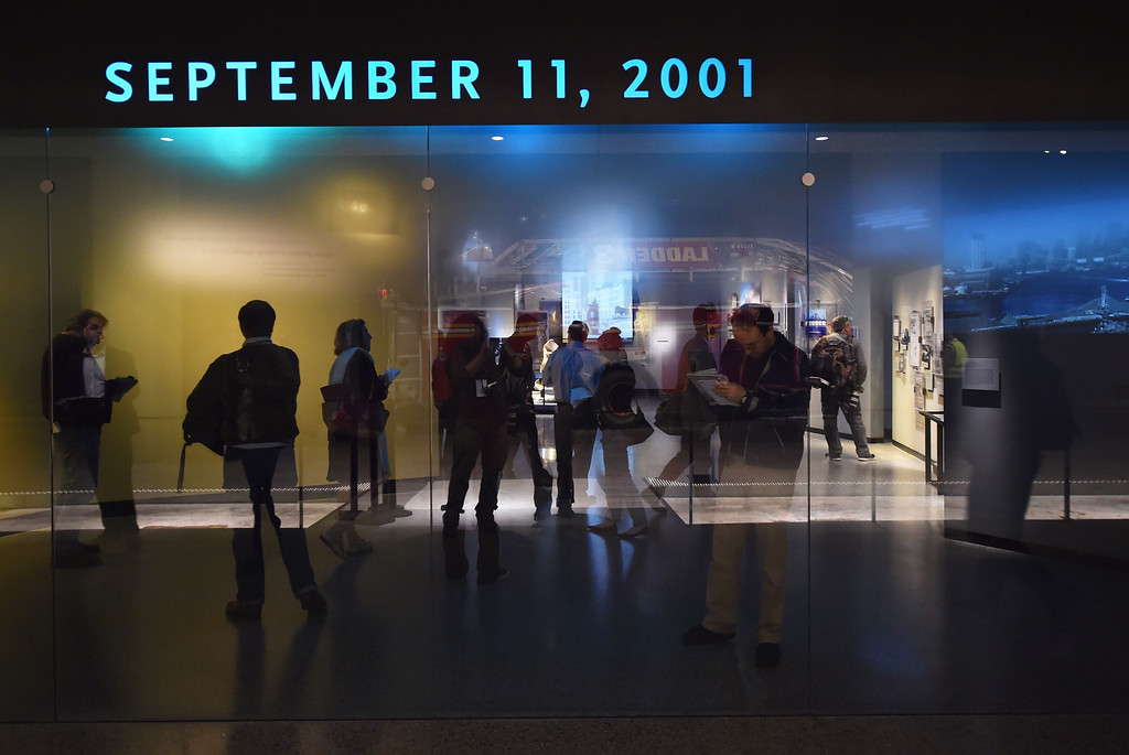 . Members of the media in the Historical Exhibition area during a press preview of the National September 11 Memorial Museum at the World Trade Center site May 14, 2014 in New York. AFP PHOTO/Stan HONDA/AFP/Getty Images