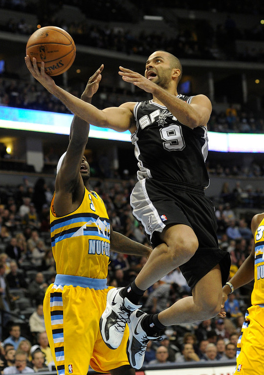 . Spurs guard Tony Parker (9) flew to the hoop past Denver guard Ty Lawson (3) in the first half. The Denver Nuggets hosted the San Antonio Spurs at the Pepsi Center Tuesday night, December 18, 2012. Karl Gehring/The Denver Post