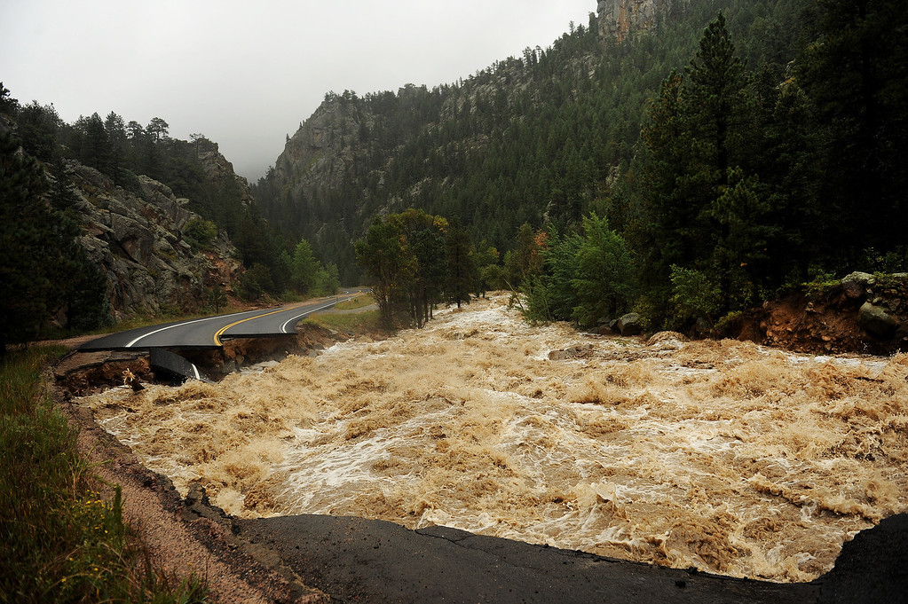 Description of . NEAR LYONS , CO - SEPTEMBER 12: Hwy 7 is completely blown out from the  South St. Vrain river as a torrent of raging water rips through it  about 12 miles west of Lyons, CO. along Highway 7 on September 12, 2013. Heavy and continuous rains created devastating flooding in many mountain communities. Some areas had over 10 inches of rain in 24-48 hours.  (Photo By Helen H. Richardson/ The Denver Post)