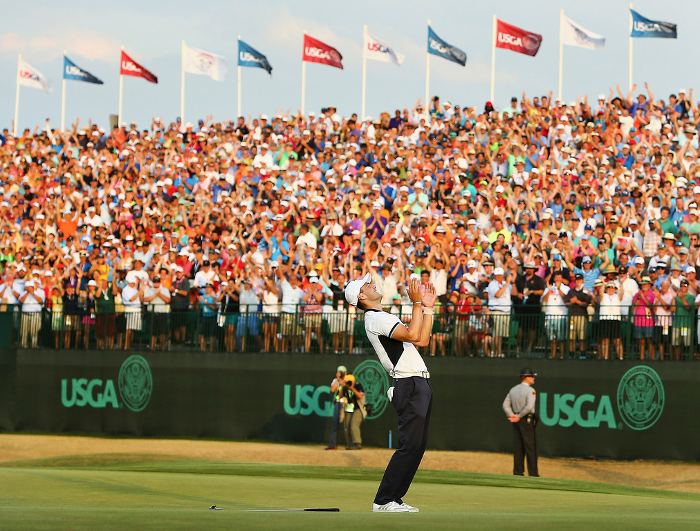 . Martin Kaymer of Germany celebrates his eight-stroke victory on the 18th green during the final round of the 114th U.S. Open at Pinehurst Resort & Country Club, Course No. 2 on June 15, 2014 in Pinehurst, North Carolina.  (Photo by Streeter Lecka/Getty Images)