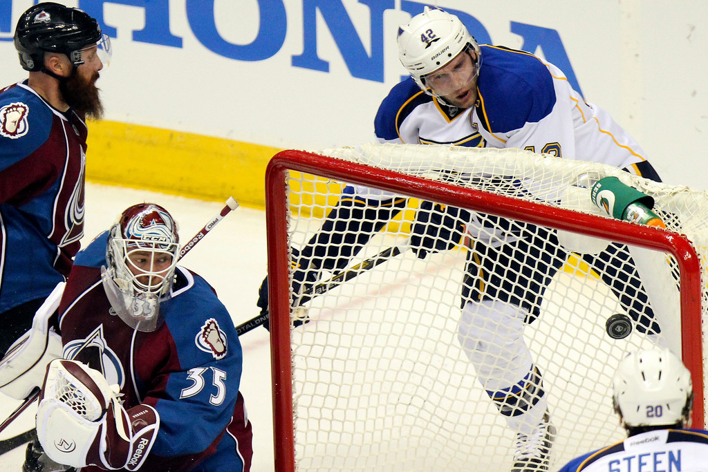 . St. Louis Blues\' David Backes (42) scores past Colorado Avalanche goalie Jean-Sebastien Giguere (35) during the first period of an NHL hockey game, Sunday, April 21, 2013, in Denver. (AP Photo/Barry Gutierrez)
