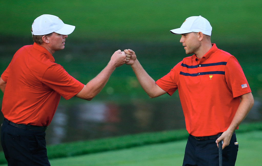 . DUBLIN, OH - OCTOBER 05:  Bill Haas (L) and Steve Stricker of the U.S. Team win the ninth hole during the Day Three Foursome Matches at the Muirfield Village Golf Club on October 5, 2013  in Dublin, Ohio.  (Photo by Matt Sullivan/Getty Images)