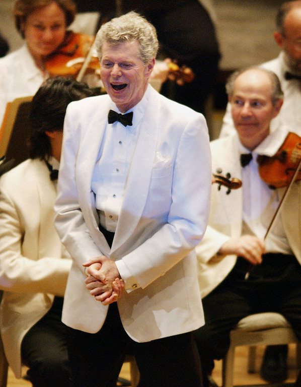 """. Pianist Van Cliburn after performing with the  Boston Symphony Orchestra on July 12, 2003 as the Orchestra plays \""""Happy Birthday,\"""" on his 69th birthday at Tanglewood in Lenox, Mass. (AP Photo/Michael Dwyer, file)"""