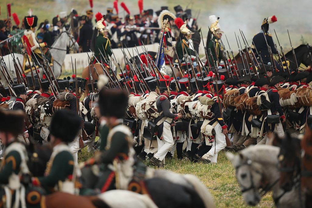 . Historical society enthusiasts in the role of troops loyal to Napoleon advance against the enemy during the re-enactment of The Battle of Nations on its 200th anniversary on October 20, 2013 near Leipzig, Germany.  (Photo by Sean Gallup/Getty Images)