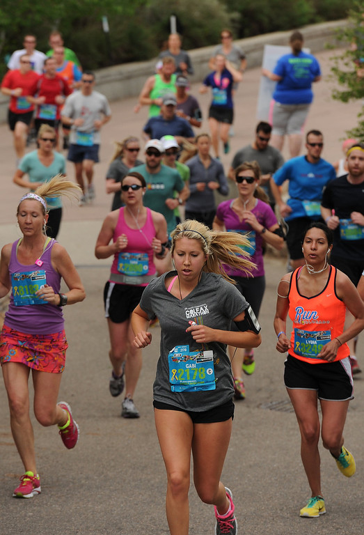. Runners make their way through the Denver Zoo at around mile 3 of the Half Marathon course on May 19, 2013.  Runners ran past camels, emus, elephants, monkeys and even a rhinoceros as they made their way through the zoo.   (Photo by Helen H. Richardson/The Denver Post)