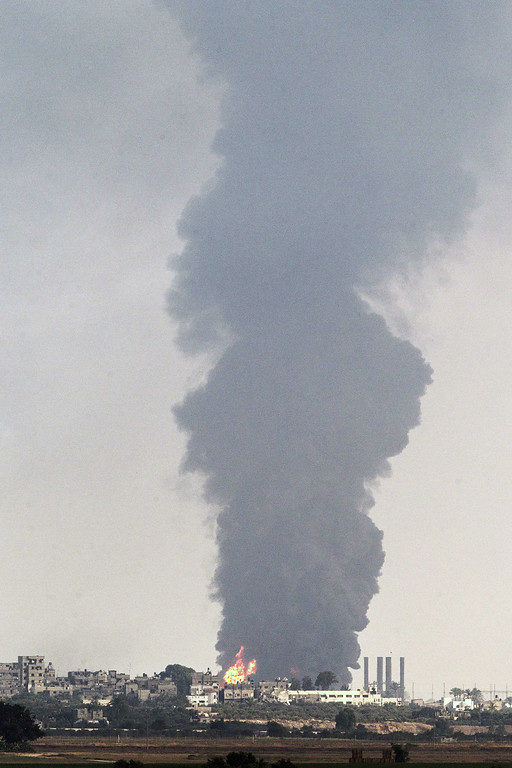 . A picture taken from the southern Israeli Gaza border shows smoke billowing from a power plant in the coastal Palestinian enclave following an Israeli air strike on July 29, 2014. The only power plant supplying electricity to the Gaza Strip was knocked out of commission by Israeli shelling, deputy director of the energy authority in the Palestinian territory said. AFP PHOTO / JACK GUEZ/AFP/Getty Images