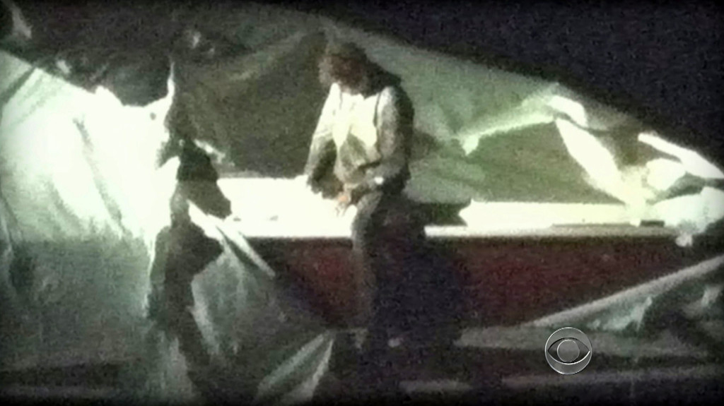 . This image obtained April 19, 2013 courtesy CBS News shows Dzhokhar Tsarnaev, a suspect in the Boston Marathon bombing who was captured Friday night, April 19, 2013  after he was found hiding in a boat in a Boston suburb.  US police captured an ethnic Chechen teenager suspected of staging the Boston marathon bombings, after a massive manhunt that virtually shut down the city and its suburbs.  After a tip from a local resident, police found Dzhokhar Tsarnaev, 19, hiding in a boat in a suburban backyard in Watertown, wounded and weary after a gun battle with police overnight in which his accomplice brother was killed.   CBS NEWS/AFP/Getty Images
