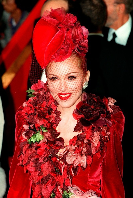 """. In this Dec. 14, 1996 file photo, \""""Evita\"""" star Madonna arrives at the film\'s premiere at the Shrine Auditorium in Los Angeles. Madonna reluctantly testified against Robert Dewey Hoskins, who was convicted in 1996 of threatening to kill the singer-actress. Hoskins served a 10 year prison sentence but escaped from a Los Angeles mental hospital in 2012 and was arrested after several days of searching by police. At trial, Madonna told a jury she felt sick to her stomach being in the same room with Hoskins, who was shot by one of her bodyguards at her Los Angeles home while she was in Florida. \""""I couldn\'t believe it was actually happening and he had tried to make his threats a reality,\"""" Madonna testified during Hoskins\' trial.  (AP Photo/Mark J. Terrill, file)"""