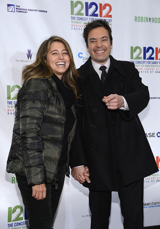 ". NEW YORK, NY - DECEMBER 12:  Nancy Fallon (L) and Jimmy Fallon attend ""12-12-12\"" a concert benefiting The Robin Hood Relief Fund to aid the victims of Hurricane Sandy presented by Clear Channel Media & Entertainment, The Madison Square Garden Company and The Weinstein Company at Madison Square Garden on December 12, 2012 in New York City.  (Photo by Dimitrios Kambouris/Getty Images)"
