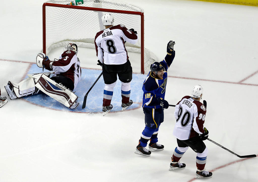 . St. Louis Blues\' Derek Roy (12) celebrates after scoring past Colorado Avalanche goalie Jean-Sebastien Giguere, left, Jan Hejda, of the Czech Republic, and Ryan O\'Reilly, right, during the first period of an NHL hockey game Thursday, Nov. 14, 2013, in St. Louis. (AP Photo/Jeff Roberson)