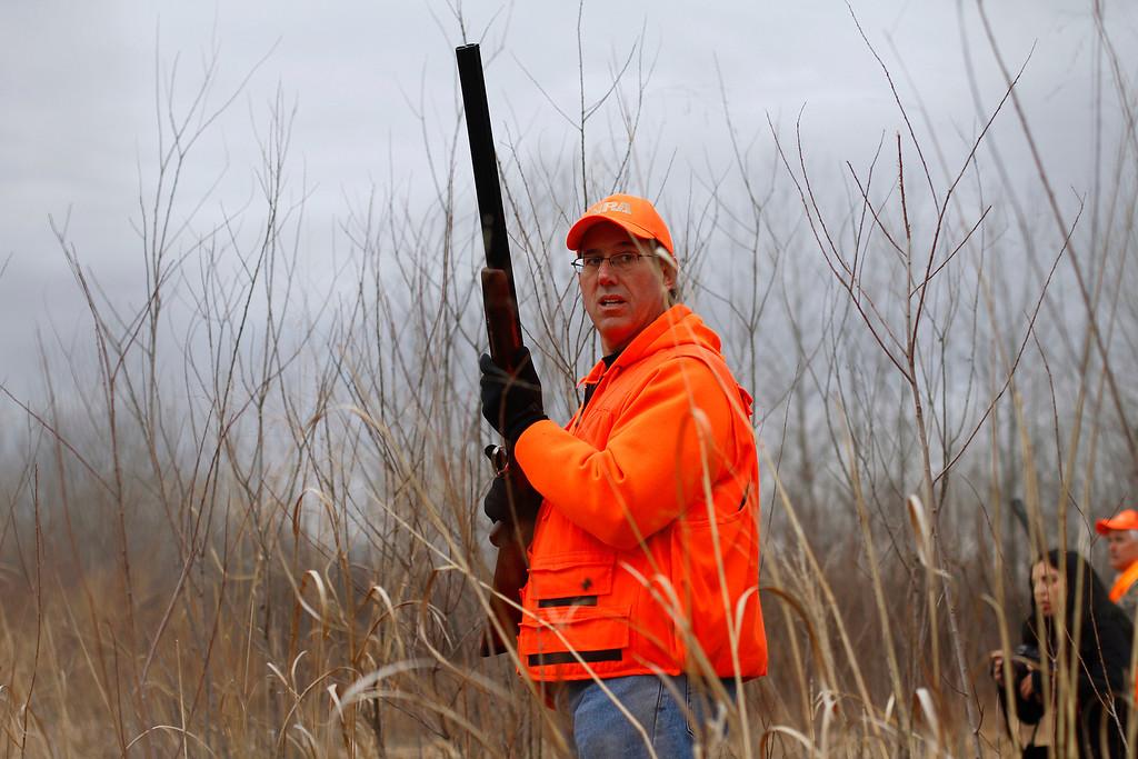 . U.S. Republican presidential candidate and former Pennsylvania Senator Rick Santorum looks on during a pheasant hunt in Adel, Iowa December 26, 2011. REUTERS/Joshua Lott